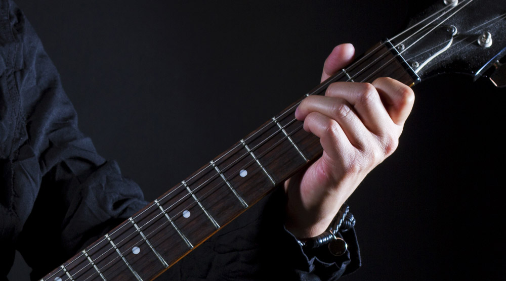 How to Play Guitar Power Chords (for Beginners) // Lessons.com